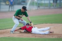 Carlos Arroyo (25) of the Hickory Crawdads slides into third base ahead of the tag by Eudor Garcia (28) of the Savannah Sand Gnats at L.P. Frans Stadium on June 14, 2015 in Hickory, North Carolina.  The Crawdads defeated the Sand Gnats 8-1.  (Brian Westerholt/Four Seam Images)
