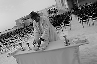 A Czech monk prepares patens and chalices for the Holy Communion in the morning before the open-air mass served by the Pope Benedict XVI in Stara Boleslav, one of the main pilgrimage site of the Czech Republic, September 28, 2009.