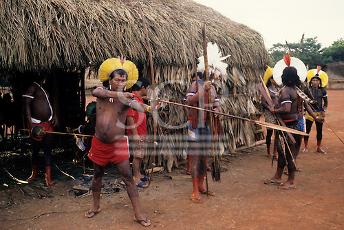 A-Ukre Village, Brazil. Kayapo Indian men preparing for the hunt at dawn; testing bow and arrows. Xingu, Para State
