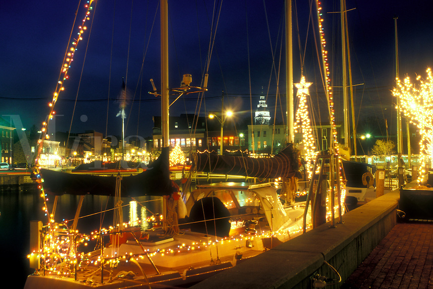 Annapolis, MD, Maryland, Sailboat decorated with lights for the Christmas holidays at City Dock in downtown Annapolis at night.
