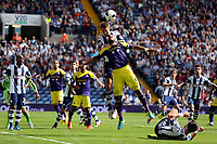Pictured: Garteh McAuley of West Brom heads the ball from above Ashley Williams of Swanseafrom a cross by the later's team mate. Sunday 01 September 2013<br /> Re: Barclay's Premier League, West Bromwich Albion v Swansea City FC at The Hawthorns, Birmingham, UK.