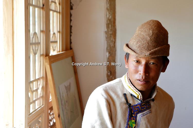 Wumu Village, Yulong County, Yunnan Province, China - Dongba priest He Jixian of the Naxi ethnic group wears traditional Naxi costumes, June 2019.