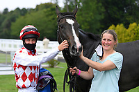 Winner of The Whiteparish Handicap  Amazon Princess (red/white) ridden by George Rooke and trained by Tony Newcombe in the Winners enclosure during Horse Racing at Salisbury Racecourse on 13th August 2020
