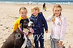 Enjoying a stroll in Ballybunion on Saturday, l to r: Lucy McEvoy, Fionn Sheehy and  Zoe McEvoy with Fia the dog.