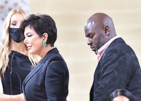 """NEW YORK, NEW YORK - SEPTEMBER 13: Kris Jenner and Corey Gamble at the 2021 Met Gala benefit """"In America: A Lexicon of Fashion"""" at Metropolitan Museum of Art on September 13, 2021 in New York City. Credit: John Palmer/MediaPunch"""