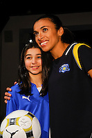Marta of the Los Angeles Sol poses for a photo with a young fan during the unveiling of the Women's Professional Soccer uniforms at the Event Place in Manhattan, NY, on February 24, 2009. Photo by Howard C. Smith/isiphotos.com