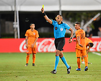 LAKE BUENA VISTA, FL - JULY 18: The referee Ismail Elfath shows a yellow card during a game between Houston Dynamo and Portland Timbers at ESPN Wide World of Sports on July 18, 2020 in Lake Buena Vista, Florida.