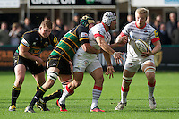 20121027 Copyright onEdition 2012©.Free for editorial use image, please credit: onEdition..Schalk Brits offloads to Jackson Wray of Saracens as he is tackled by GJ van Velze (2nd left) and Dylan Hartley of Northampton Saints during the Aviva Premiership match between Northampton Saints and Saracens at Franklin's Gardens on Saturday 27th October 2012 (Photo by Rob Munro)..For press contacts contact: Sam Feasey at brandRapport on M: +44 (0)7717 757114 E: SFeasey@brand-rapport.com..If you require a higher resolution image or you have any other onEdition photographic enquiries, please contact onEdition on 0845 900 2 900 or email info@onEdition.com.This image is copyright the onEdition 2012©..This image has been supplied by onEdition and must be credited onEdition. The author is asserting his full Moral rights in relation to the publication of this image. Rights for onward transmission of any image or file is not granted or implied. Changing or deleting Copyright information is illegal as specified in the Copyright, Design and Patents Act 1988. If you are in any way unsure of your right to publish this image please contact onEdition on 0845 900 2 900 or email info@onEdition.com