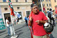 Former city councilor Nunzio D'Erme during the demonstration of the workers of Alitalia together with the trade unions in Piazza San Silvestro.<br /> Rome (Italy), September 10th 2021<br /> Photo Samantha Zucchi Insidefoto