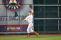 Texas Longhorns left fielder Ben Johnson #14 tracks a fly ball against the Rice Owls at Minute Maid Park on February 28, 2014 in Houston, Texas.  The Longhorns defeated the Owls 2-0.  (Brian Westerholt/Four Seam Images)