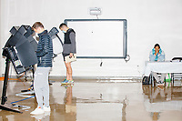 Voters use electronic voting machines to fill out their ballots in the School without Walls High School Ward 2 polling location in the Foggy Bottom area of Washington, D.C., on Election Day, Tue., Nov. 3, 2020. Poll workers said that the polling location was pretty quiet most of the day due to substantial mail-in voting done in DC.