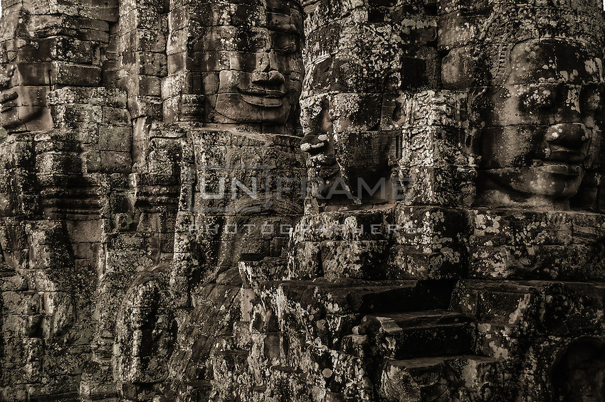 UNESCO World Heritage Site,  the ruins of the Ankgor Wat temples. Roots of secular forest trees swallow the Khmer architecture ancient buildings.   The future of the monumental complex relies on a very delicate and complex balance between preservation and intensive tourist exploitation.   Seam Reap, Cambodia.