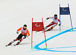 15/03/2014. Canadian skier Mac Marcoux and guide Robin Femy compete in the mens's giant slalom visually impared at the Sochi 2014 Paralympic Winter Games in Sochi Russia. Photo(Scott Grant/Canadian Paralympic Committee)