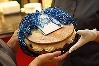Pictured: A cake prepared by the Lotto winners by their colleagues at Neath Port Talbot hospital. Wednesday 08 November 2017<br /> Re: Presentation of hospital catering syndicate win £25m in Euromillions Jackpot at Hensol Castle, south Wales, UK. Julie Saunders, 56, Doreen Thompson, 56, Louise Ward, 37, Jean Cairns, 73, SIan Jones, 54 and Julie Amphlett, 50 all work as catering staff for Neath Port Talbot Hospital in south Wales.