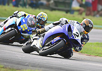 Ben Bostrum leads Tommy Hayden during Sunday's American Suprbike race at the Suzuki Big Kahuna Nationals, Virginia International Raceway, Alton, VA, August 2009. (Photo by Briain Cleary/www.bcpix.com)