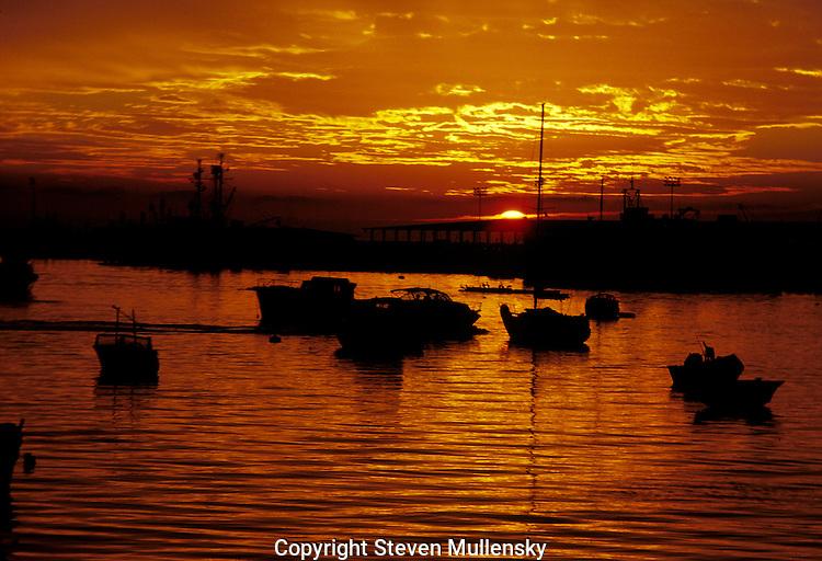 A peaceful harbor at sundown.