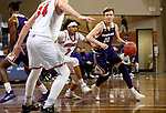 SIOUX FALLS, SD - MARCH 6: Colton Sandage #20 of the Western Illinois Leathernecks drives past Xavier Fuller #3 of the South Dakota Coyotes during the Summit League Basketball Tournament at the Sanford Pentagon in Sioux Falls, SD. (Photo by Dave Eggen/Inertia)