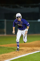 Chris Clare (9) of the High Point Panthers hustles towards home plate against the Davidson Wildcats at Willard Stadium on March 24, 2015 in High Point, North Carolina.  The Panthers defeated the Wildcats 15-2.  (Brian Westerholt/Four Seam Images)
