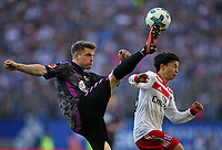 21.04.2018, Football 1. Bundesliga 2017/2018, 31.  match day, Hamburger SV - SC Freiburg, Volksparkstadium Hamburg.  Lukas Kuebler (Freiburg)  -  Tatsuya Ito (Hamburg)  *** Local Caption *** © pixathlon<br /> <br /> Contact: +49-40-22 63 02 60 , info@pixathlon.de