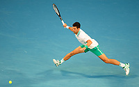 February 21, 2021: 1st seed Novak Djokovic of Serbia in action against 4th seed Daniil Medvedev of the Russian Federation in the Men's Final match match on day 14 of the 2021 Australian Open on Rod Laver Arena, in Melbourne, Australia. Photo Sydney Low.