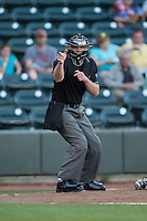 Home plate umpire Brock Ballou makes a strike call during the Carolina League game between the Potomac Nationals and the Winston-Salem Dash at BB&T Ballpark on May 13, 2016 in Winston-Salem, North Carolina.  The Dash defeated the Nationals 5-4 in 11 innings.  (Brian Westerholt/Four Seam Images)