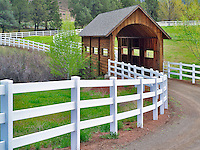 Covered bridge and fence. Near Mitchel, OR