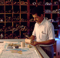 Geologist examining core samples from oil survey drilling. North Africa.