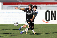 RICHMOND, VA - SEPTEMBER 30: Jake LaCava #64 of New York Red Bulls II is chased by Graham Smith #16 of North Carolina FC during a game between North Carolina FC and New York Red Bulls II at City Stadium on September 30, 2020 in Richmond, Virginia.