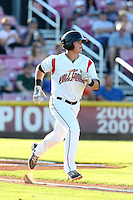 Christian Arroyo #15 of the Salem-Keizer Volcanoes runs to first base during a game against the Spokane Indians at Volcanoes Stadium on July 26, 2014 in Keizer, Oregon. Spokane defeated Salem-Keizer, 4-1. (Larry Goren/Four Seam Images)