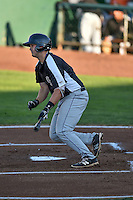Hunter Melton (15) of the Grand Junction Rockies follows through on his swing against the Ogden Raptors during the Pioneer League game at Lindquist Field on August 25, 2016 in Ogden, Utah. The Rockies defeated the Raptors 12-3. (Stephen Smith/Four Seam Images)