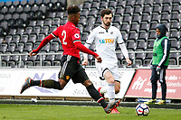 Sunday 18 March 2018<br /> Pictured:  Ethan Laird of Manchester United challenges Matic Paljk of Swansea City<br /> Re: Swansea City v Manchester United U23s in the Premier League 2 at The Liberty Stadium on March 18, 2018 in Swansea, Wales.