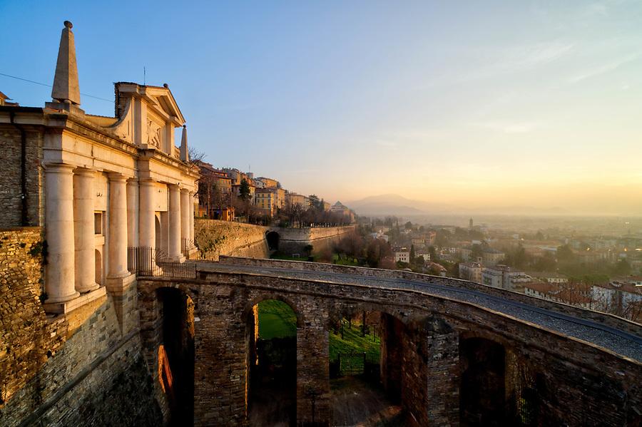 Porta San Giacomo and Bergamo's big Venetian walls at sunrise, Bergamo Città Alta, Italy