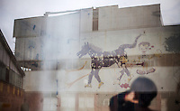 05.06.2013, Potocari ( Srebrenica ) Bosnia Herzegovina<br /> Parte del muro della base delle forze Onu olandesi riflessa sulla finestra di una delle stanze dove vennero segregate le donne di Sebrenica. Sule mura i disegni delle donne. <br /> L'esercito Serbo nel 1995 ha massacrato a Srebrenica circa 8.000 tra uomini e ragazzi Musulmani, la piu' grande atrocita' commessa in Europa dalla seconda guerra mondiale. <br /> Foto Insidefoto / EXPA/ Juergen Feichter