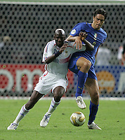 Italian forward (9) Toni Luca fights for the ball with French midfielder (18) Alou Diarra.  Italy defeated France on penalty kicks after leaving the score tied, 1-1, in regulation time in the FIFA World Cup final match at Olympic Stadium in Berlin, Germany, July 9, 2006.