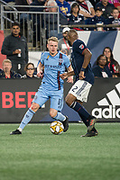 FOXBOROUGH, MA - SEPTEMBER 29: Andrew Farrell #2 of New England Revolution comes in to tackle Gary Mackay-Steven #17 of New York City FC during a game between New York City FC and New England Revolution at Gillettes Stadium on September 29, 2019 in Foxborough, Massachusetts.