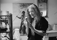 Liz Fritsch, potter, lived at Digswell House, an artists' community run by the Digswell Arts Trust, Welwyn Garden City, Hertfordshire, UK.  1977. Other artists there at the time included: Lol Coxhill, jazz saxophonist, Veryan Weston, jazz pianist, John Blakeley, sculptor, Patricia Leighton, sculptor and John Walmsley, photographer.