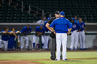 Home plate umpire Ray Patchen explains a batter interference call to AZL Cubs manager Carmelo Martinez during a game between the AZL Cubs and AZL Giants on September 6, 2017 at Sloan Park in Mesa, Arizona. AZL Giants defeated the AZL Cubs 6-5 to even up the Arizona League Championship Series at one game a piece. (Zachary Lucy/Four Seam Images)
