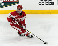 WORCESTER, MA - FEBRUARY 08: Alexandra Calderone #4 of Boston University brings the puck forward during a game between Boston University and College of the Holy Cross at Hart Center Rink on February 08, 2020 in Worcester, Massachusetts.