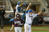 UCLA pitcher David Berg (26) celebrates the final out of the 2013 Men's College World Series against the Mississippi State Bulldogs on June 25, 2013 at TD Ameritrade Park in Omaha, Nebraska. The Bruins defeated the Bulldogs 8-0, winning the National Championship. (Andrew Woolley/Four Seam Images)