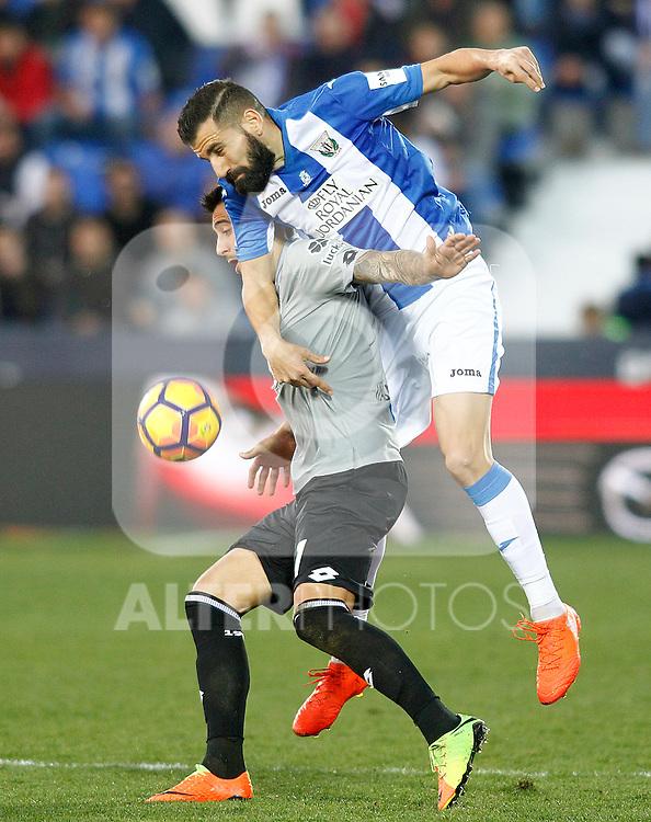 CD Leganes' Dimitrios Siovas (r) and Deportivo de la Coruna's Carles Gil during La Liga match. February 25,2017. (ALTERPHOTOS/Acero)