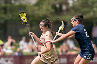 NEWTON, MA - MAY 22: Sydney Scales #45 of Boston College brings the ball forward as Meaghan Scutaro #25 of Notre Dame defends during NCAA Division I Women's Lacrosse Tournament quarterfinal round game between Notre Dame and Boston College at Newton Campus Lacrosse Field on May 22, 2021 in Newton, Massachusetts.