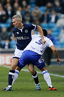 Steve Morison of Millwall and Maxime Colin of Birmingham City tangle during the Sky Bet Championship match between Millwall and Birmingham City at The Den, London, England on 21 October 2017. Photo by Carlton Myrie.