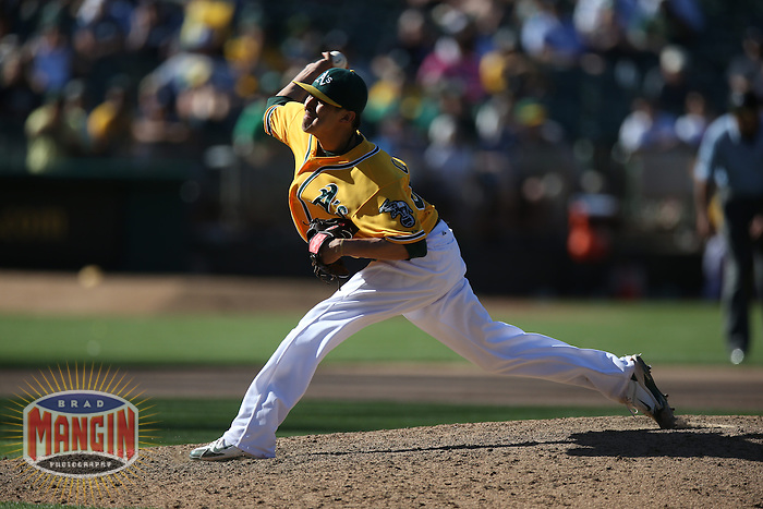 OAKLAND, CA - JUNE 13:  Jesse Chavez #60 of the Oakland Athletics pitches against the New York Yankees during the game at O.co Coliseum on Thursday June 13, 2013 in Oakland, California. Photo by Brad Mangin