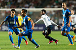 Tottenham Hotspur midfielder Georges-Kevin Nkoudou (C) fights for the ball with SC Kitchee Defender Krisztin Vadocz (R) during the Friendly match between Kitchee SC and Tottenham Hotspur FC at Hong Kong Stadium on May 26, 2017 in So Kon Po, Hong Kong. Photo by Man yuen Li  / Power Sport Images