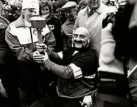 Montreal (Qc) CANADA -  Dec 12 1987 File Photo - Mad Dog vachon hold the Olympic Flame while it pass through Montreal downtown