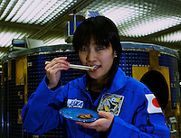 Naoko Iwata, Thermal system Engineer at the Japan Aerospace and Exploration Agency, eats silk worm larvae. Silk work larvae will provide protein and animal fats in a future space agricultural system that is being implemented for a Mars space station.