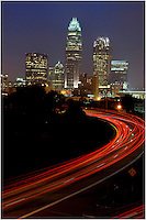 Charlotte skyline at night with red tail lights of vehicles driving. Please visit www.PatrickSchneiderPhoto.com for Charlotte's most up-to-date and extensive collection of Charlotte NC photos.