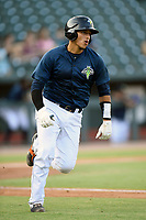 Catcher Juan Uriarte (17) of the Columbia Fireflies runs out a batted ball in a game against the Rome Braves on Tuesday, June 4, 2019, at Segra Park in Columbia, South Carolina. Columbia won, 3-2. (Tom Priddy/Four Seam Images)