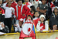 BOGOTA -COLOMBIA, 9-07-2013. Hinchas del Independiente Santa Fe de Colombia durante el encuentro con Olimpia del Paraguay , partido de la semifinal de la Copa Bridgestone  Libertadores de América , jugado en el estadio Nemesio Camacho El Campín de la ciudad de Bogotá./ Fans of Colombia's Independiente Santa Fe during the meeting with Olimpia of Paraguay, semifinal match of the Copa Libertadores Bridgestone, played at the Estadio Nemesio Camacho El Campin in Bogota.<br /> . Photo: VizzorImage/ Felipe Caicedo/ STAFF