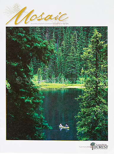 Nelson Kenter photo of fishermen in a canoe on a lake surrounded by forest. Used on a National Forest publication cover